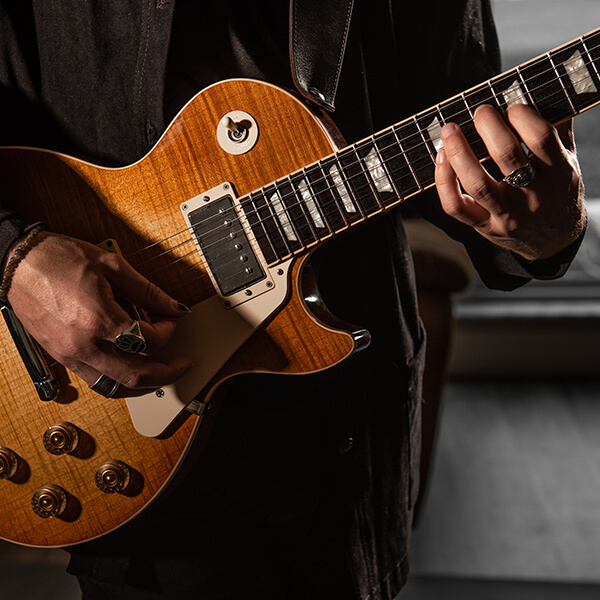 close up of George Pennington playing les paul