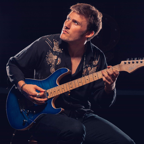 George Pennington playing a Cort electric guitar