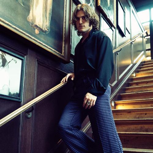 George Pennington walking down a staircase