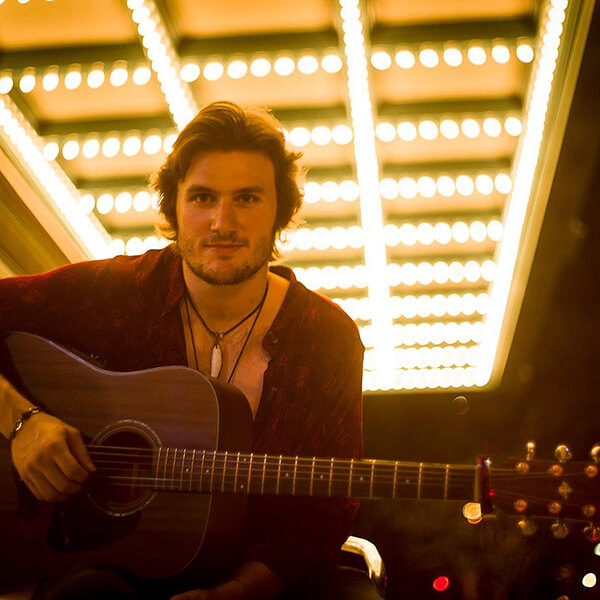 George Pennington with an acoustic guitar