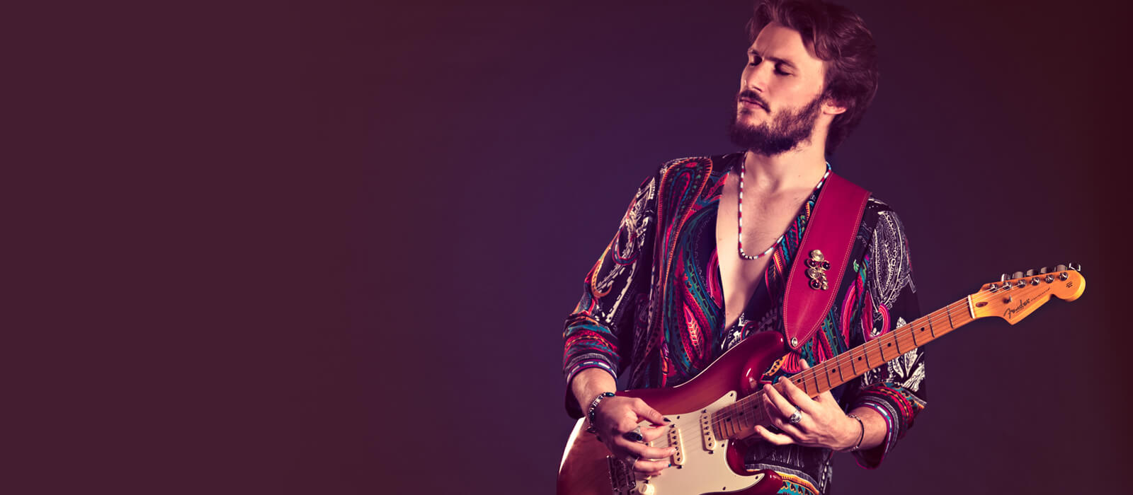George Pennington in paisley shirt with strat